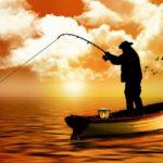 ボートで釣りをするシルエット